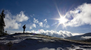 Hiker on a winter hill Stock Images