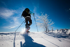 Hiker in winter mountains Royalty Free Stock Images