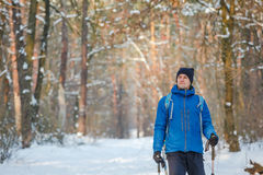 Hiker in winter mountains Royalty Free Stock Photo