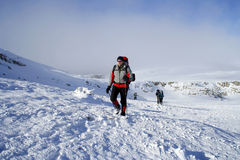 Hiker in winter mountains Stock Photography