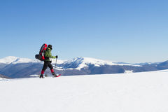 Hiker in winter mountains snowshoeing. Royalty Free Stock Photography