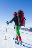 Hiker in winter mountains snowshoeing. Stock Photo