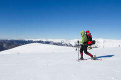 Hiker in winter mountains snowshoeing. Stock Photography