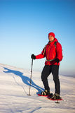 Hiker in winter mountains snowshoeing. Royalty Free Stock Image