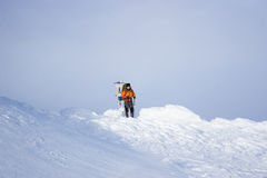 Hiker in winter mountains snowshoeing. Royalty Free Stock Photos