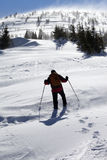 Hiker in winter mountains at sunny windy day Stock Photography