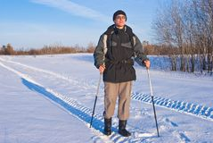 Hiker on a winter road Royalty Free Stock Photography