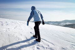 Hiker on the winter snow field Stock Image