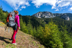 Hiker woman with backpack Stock Photos