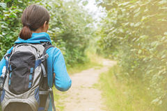 Hiker woman with backpack, rear view Royalty Free Stock Images