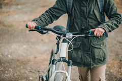 Hiker woman with bicycle in the forest Royalty Free Stock Photo