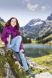 Hiker woman during a break Royalty Free Stock Image