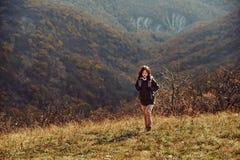 Hiker woman climbing the hill Stock Photo