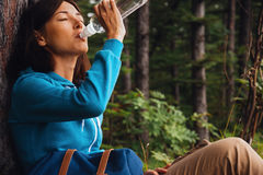 Hiker woman drinks water Stock Photos