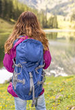 Hiker woman enjoying the lake view Royalty Free Stock Photos