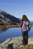 Hiker woman enjoying the mountain landscape in autumn Stock Photography