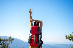 Hiker woman feeling victorious facing on the mountain, Royalty Free Stock Image