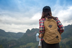 Hiker woman feeling victorious facing on the mountain, Stock Photo