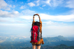 Hiker woman feeling victorious facing on the mountain, Royalty Free Stock Images