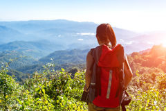 Hiker woman feeling victorious facing on the mountain Stock Images