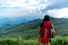 Hiker woman feeling victorious facing on the mountain, Royalty Free Stock Photo