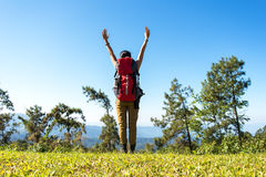 Hiker woman feeling victorious facing on the mountain, Royalty Free Stock Photos