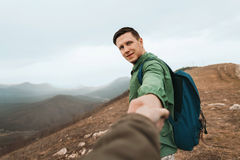 Hiker woman follows a man on nature Stock Photography