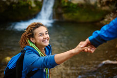 Hiker woman getting help stock images