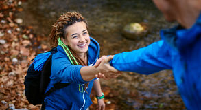 Hiker woman getting help Royalty Free Stock Photos