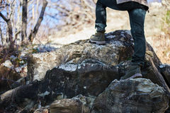 Hiker woman go up on rock, view of legs Royalty Free Stock Photo