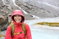 Hiker woman hiking with backpack in rain on trek Stock Photo