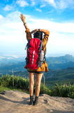 Hiker woman look binoculars on the mountain, Royalty Free Stock Image