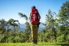 Hiker woman look binoculars on the mountain,. Background blue sky, Thailand Royalty Free Stock Photo