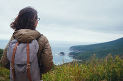 Hiker woman looking into distance to the island Royalty Free Stock Photo