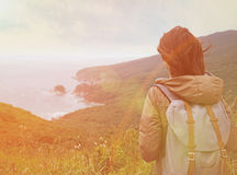 Hiker woman looking to the island in summer Royalty Free Stock Photo
