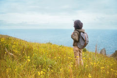 Hiker woman looks on the sea Royalty Free Stock Image