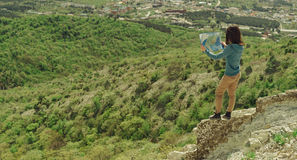 Hiker woman with a map outdoor Stock Image