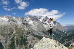 Hiker woman and mountain panorama Royalty Free Stock Photo