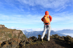Hiker woman at mountain peak Stock Photography