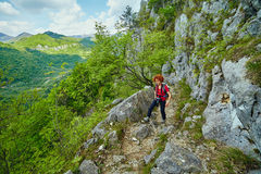 Hiker woman on a mountain trail Stock Photo