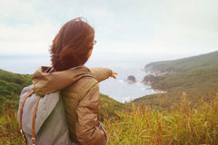 Hiker woman pointing to the island in summer Stock Image