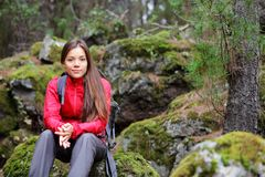 Hiker woman portrait in forest. Hiking. Woman hiker in forest taking a rest sitting down. Beautiful young Asian Caucasian model. From La Caldera, Aguamansa Stock Images