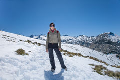 Hiker woman posing in snow mountains Royalty Free Stock Images