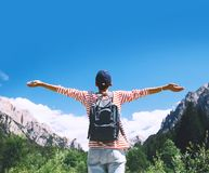 Woman with raised arms up on nature in Dolomites, South Tyrol, Italy, Europe. Hiker woman with raised arms up on nature outdoors, back view. Travel at Dolomites stock photos