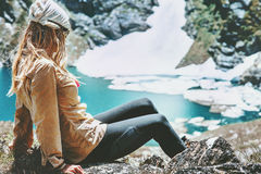 Hiker woman relaxing at blue lake in mountains Royalty Free Stock Photos