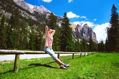 Hiker woman spend summer holiday in Dolomites, South Tyrol, Ital Stock Images
