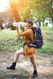 Hiker woman resting drinking water, Stock Photos
