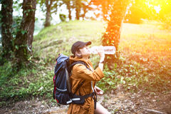 Hiker woman resting drinking water Stock Image