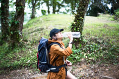 Hiker woman resting drinking water Stock Photo