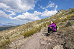 Hiker woman resting sitting in footpath Guadarrama Royalty Free Stock Images